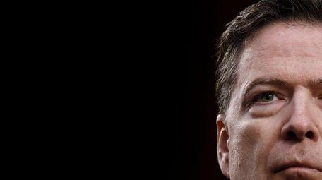 Former FBI Director James Comey testifies during a