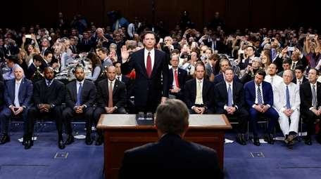 Former FBI Director James Comey is sworn in