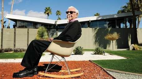 Architect William Krisel in front of one of