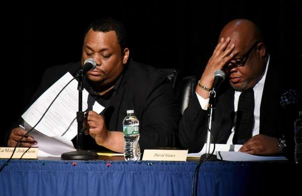 Hempstead school board trustee LaMont Johnson, left, is