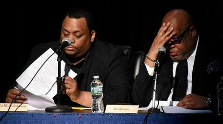 Hempstead school board trustee LaMont Johnson, left, is