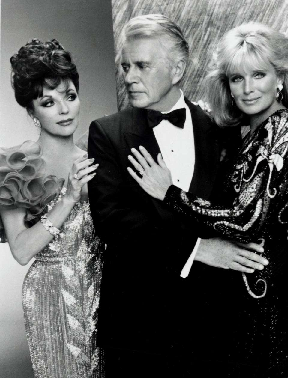Joan Collins, John Forsythe and Linds Evans in