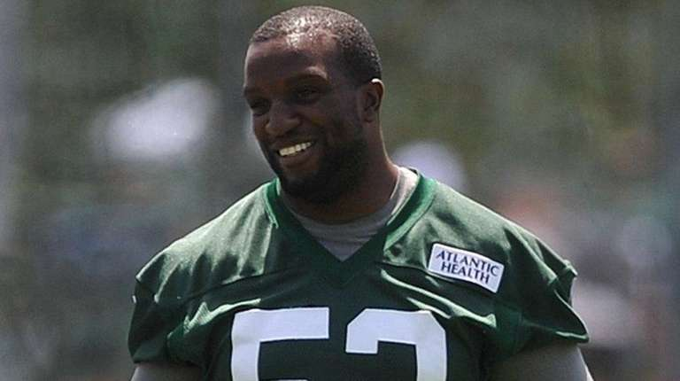 David Harris #52 of New York Jets laughs