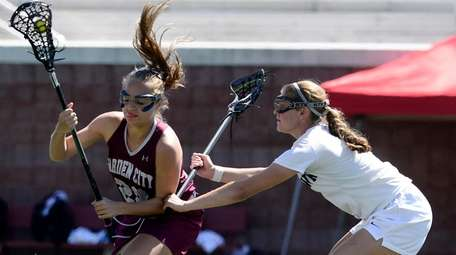 Garden City's Taylor Gladd, left, is defended by