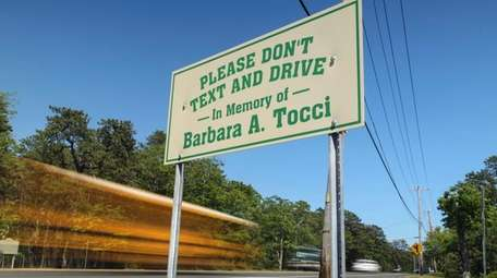 A pair of signs urging motorists not to