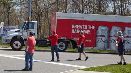 Clare Rose striking workers confront a truck with
