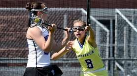 Mattituck-Southold's Sarah Bihm, right, defends against Bronxville's Olivia