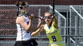 Mattituck-Southold's Sarah Bihm, right, defends against Bronxville's Olivia