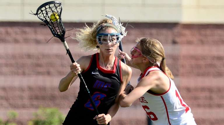 Middle Country's Rachel Masullo, left, is defended by