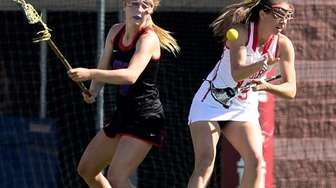 Middle Country's Jamie Ortega, left, knocks the ball