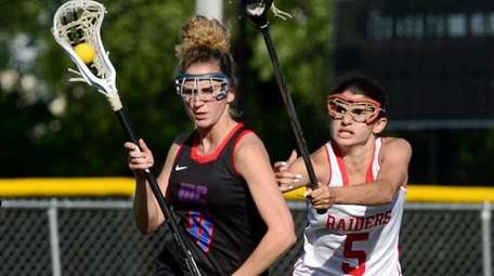 Middle Country's Amanda Masullo, left, drives past North