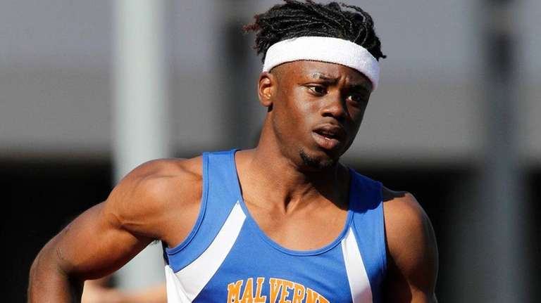Maurice Teachey of Malverne competes in the 4x400-meter