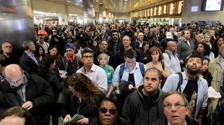 Long Island Rail Road passengers wait for their