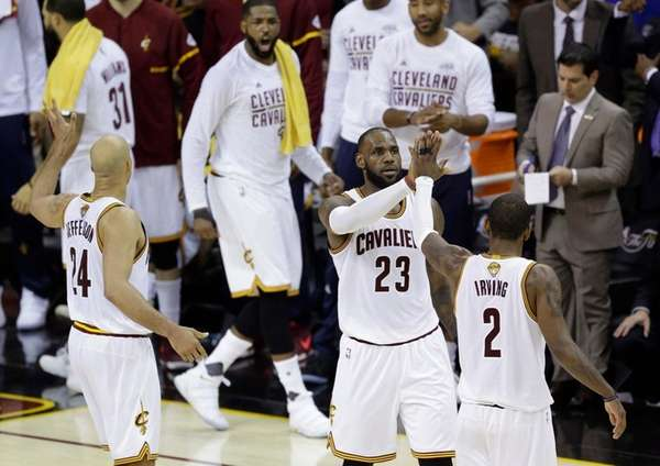 Cleveland Cavaliers forward LeBron James and teammate Kyrie