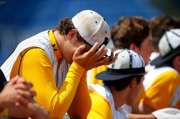 Chris DeSousa of Massapequa is emotional after losing