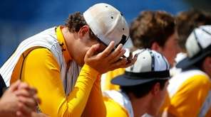 Chris DeSousa of Massapequa is emotional after losing
