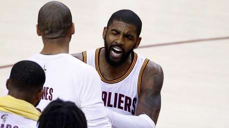 Kyrie Irving of the Cleveland Cavaliers celebrates
