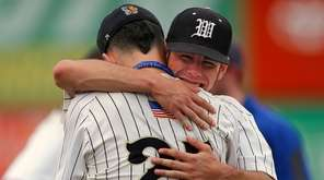 Pitcher Brendan Has (25) of Wantagh is hugged