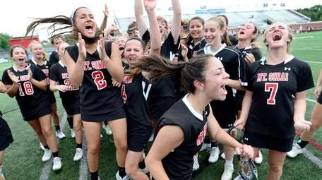 Mount Sinai players celebrate their win in the