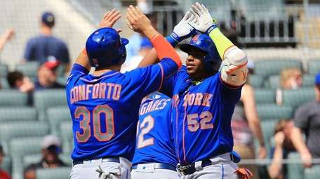Yoenis Cespedes, right, who just hit a game-breaking