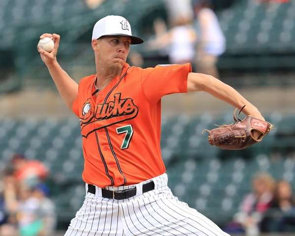 Ducks starting pitcher John Brownell #7 delivers a