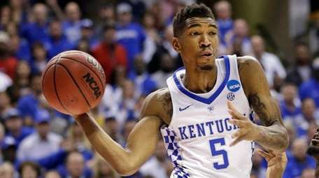Kentucky guard Malik Monk makes a pass around