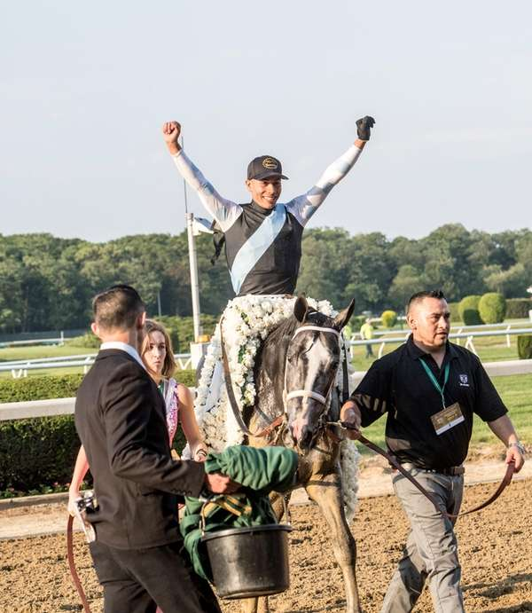 Jose Ortiz celebrates after riding Tapwrit to victory