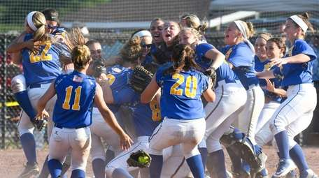 East Meadow players go wild after 1-0 win