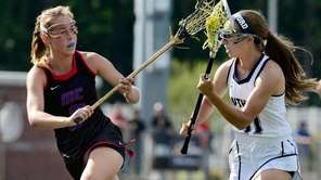 Middle Country's Jamie Ortega, left, defends against Pittsford's