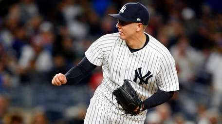 Chad Greenof the New York Yankees pitches against