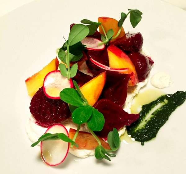 A salad of beets, sliced peaches and pea