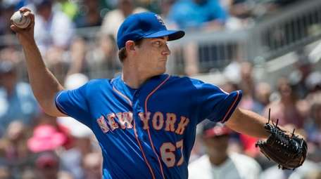 New York Mets' Seth Lugo pitches against the
