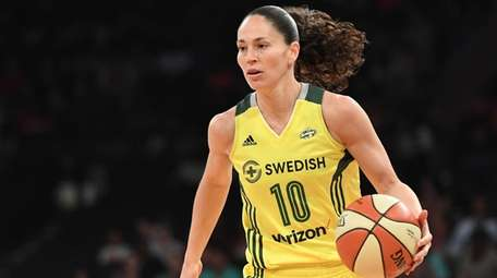 Seattle Storm guard Sue Bird controls the ball
