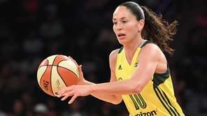 Seattle Storm guard Sue Bird drives the ball