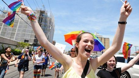 Sophia Conrad of Long Beach cheers during the
