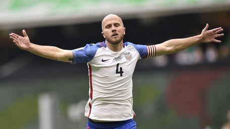 US midfielder Michael Bradley celebrates after scoring against