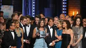 Producer Stacey Mindich, center, and the cast and