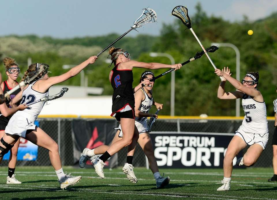 Middle Country's Rachel Masullo, center, gets a shot