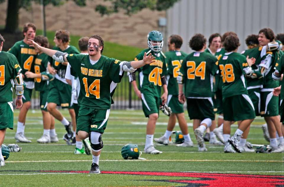 The Ward Melville boys lacrosse team celebrates its