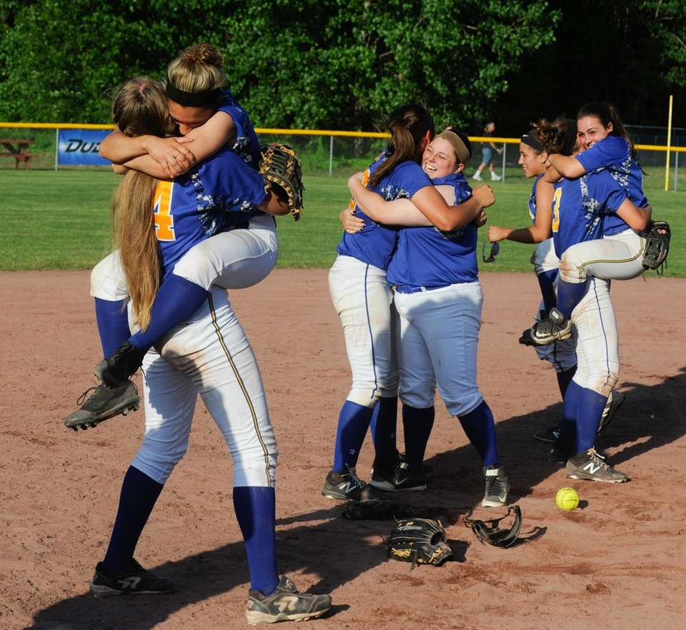 East Meadow softball players celebrate their win over