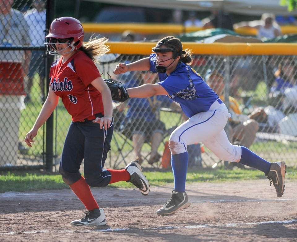East Meadow's Amy Mallah, right, tags out Binghamton's