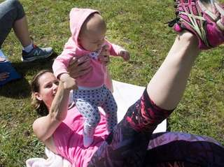 Krista Cardillo and her 7-month-old daughter, Charlie, move