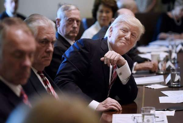President Donald Trump smiles during a Cabinet meeting