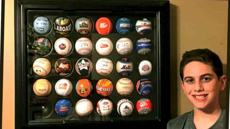 Ryan Maggio of Wantagh with his baseball collection