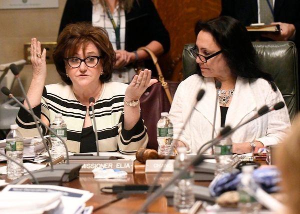 State Education Commissioner MaryEllen Elia, left, speaks as