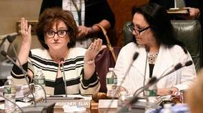 State Education Commissioner MaryEllen Elia, left, speaks as