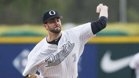 David Peterson of Oregon pitches during a game