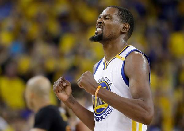 Golden State Warriors forward Kevin Durant reacts after