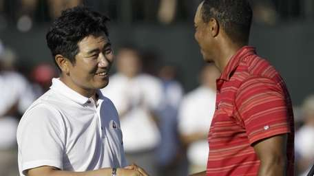 Y.E. Yang, of South Korea, is congratulated by