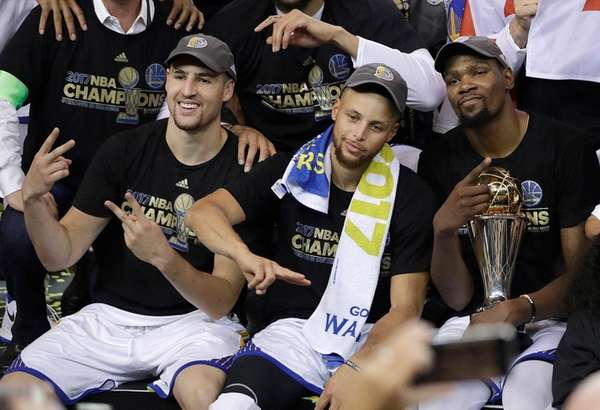 Golden State Warriors guard Klay Thompson, from left,